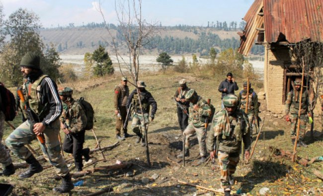 Army soldiers patrolling after an IED was recovered in a gas cylinder near the Circuit House...