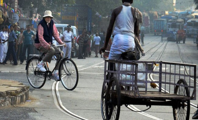 Amitabh Bachhan rides a bicycle during the shooting of his upcoming film Piku...