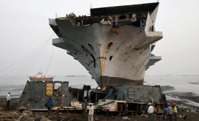 Decommissioned warship, INS Vikrant being wrecked at Darukhana ship breaking yard in Mumbai...