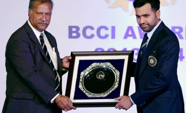 Interim President, BCCI Shivlal Yadav felicitates Indian cricketer Rohit Sharma at the BCCI...