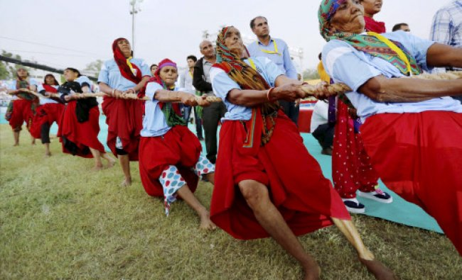 Elderly women take part in Tug-of War during annual month long sports competition...