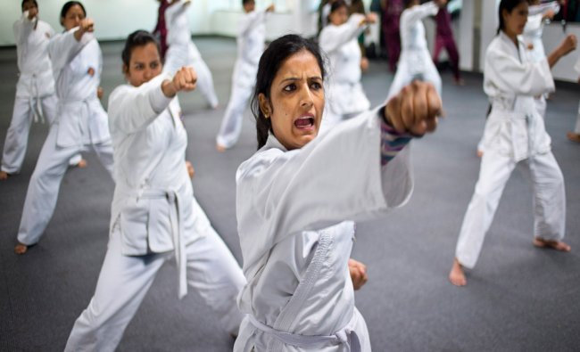 Women from the Delhi police force, undergo martial arts training...