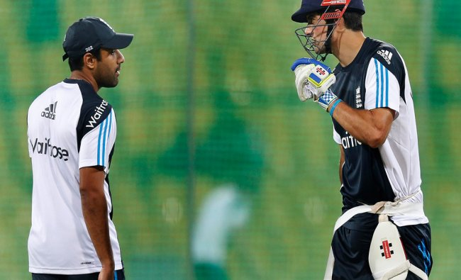 England\'s captain Alastair Cook (R) talks with his teammate Ravi Bopara...