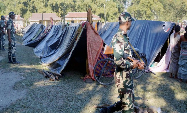 Security personnel guard a relief camp at Balapara where Bodo people took shelter...