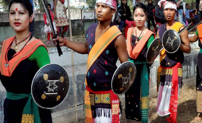 Tribal artistes perform \'Mishing dance\' during a new year function at Srimanta Sankardev...