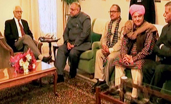Jammu and Kashmir BJP members in a meeting with state Governor NN Vohra at Raj Bhawan...