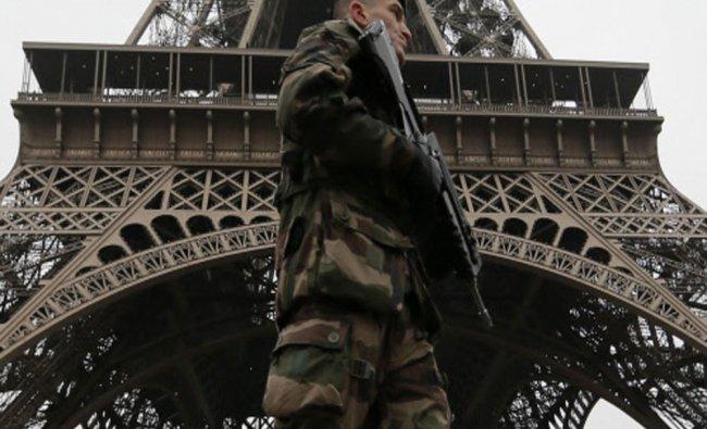 French soldier patrols near the Eiffel Tower...