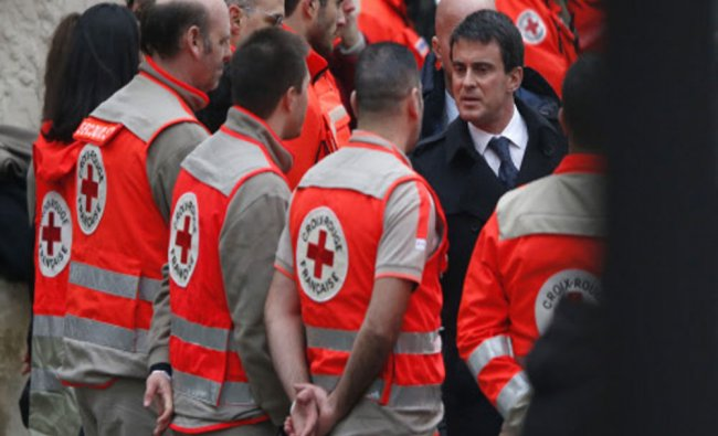 French Prime Minister Manuel Valls speaks with members of the Red Cross