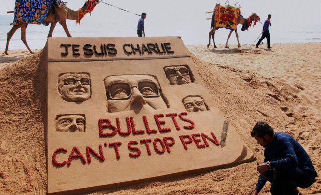 Sand artist Sudarsan Pattnaik creates a sand sculpture to condemn the terrorist attack at a media...