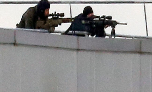 French special forces sharp shooters take position on a rooftop...
