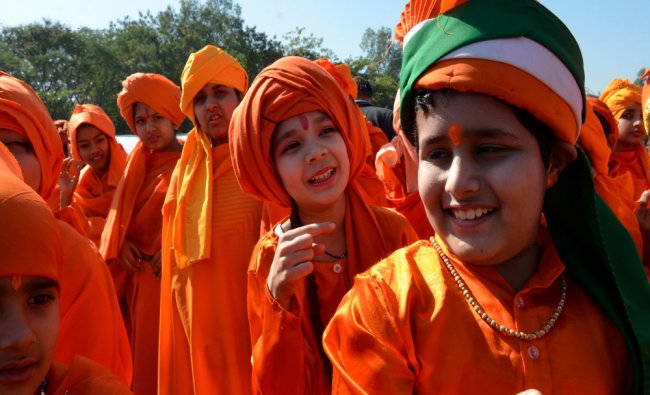 School children dressed as Swami Vivekanand sharing lighter moments in a Mass...