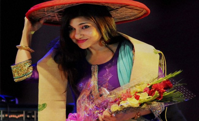 Alka Yagnik felicitated with the Jaapi during a cultural function...