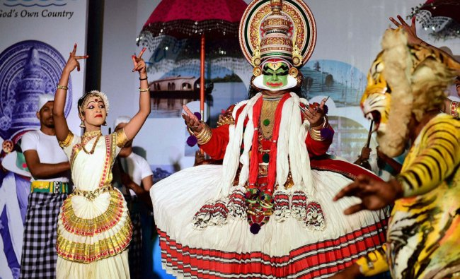 Artists from Kerala perform during a promotional event of Kerala tourism in Bengaluru...