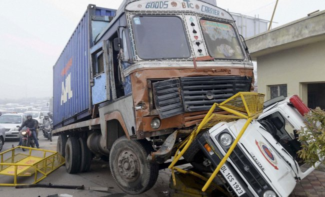 A truck and a police vehicle after an accident in New Delhi on Tuesday.