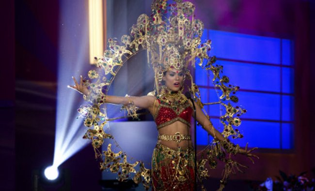 Miss India, Noyonita Lodh, poses for the judges, during the national costume show during...