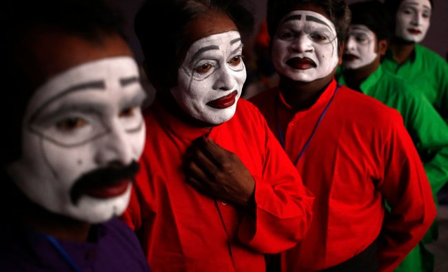 Artists wait for their turn to perform during a media preview for the Republic Day parade...