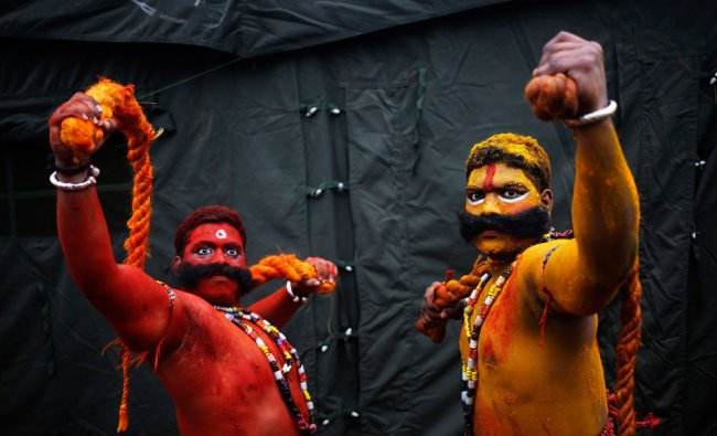Artists from the southern Indian state of Telangana, perform during a media preview