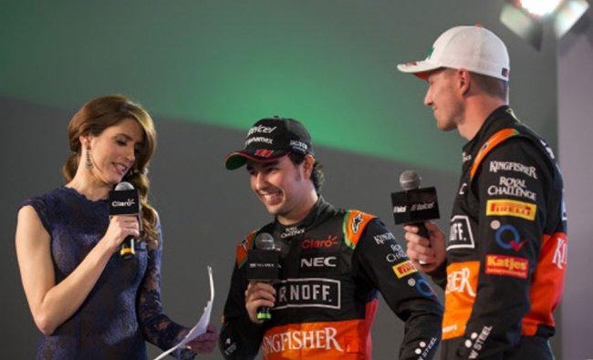 Drivers Sergio Perez, center, and Nico Hulkenberg, right, answer prepared questions...