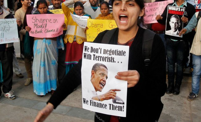 Activists from Communist Party of India Liberation shout slogans during a protest against U.S...
