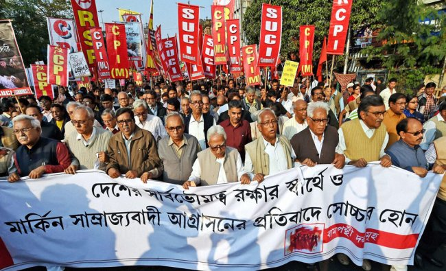 Left leaders participate in a rally in Kolkata on Saturday to protest against US President Obama...