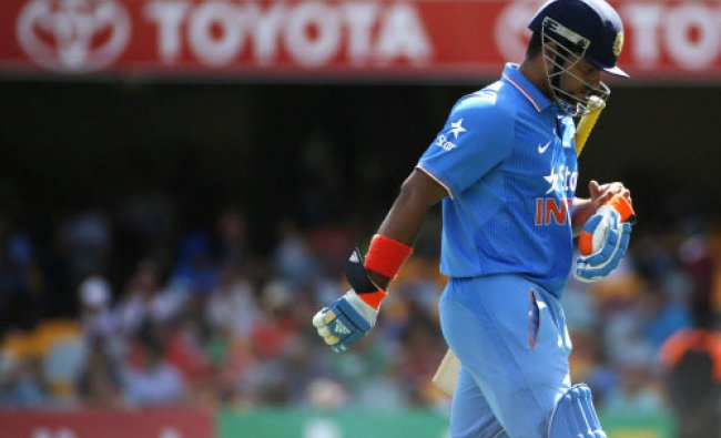 India\'s batsman Virat Kohli walks off the field after being caught out by England\'s ...