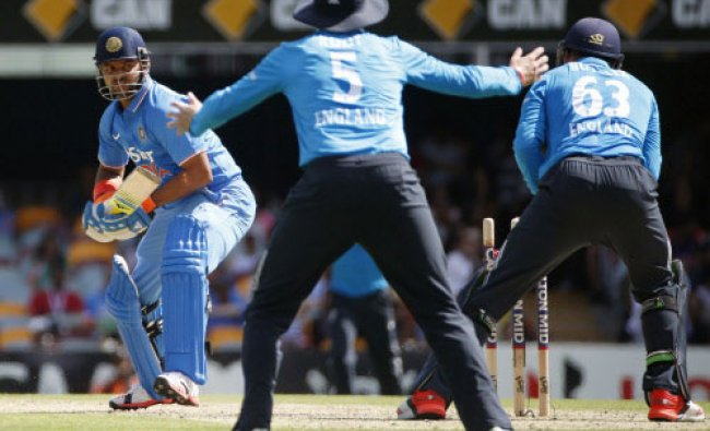 India\'s batsman Suresh Raina (L) is stumped by England\'s wicketkeeper Jos Buttler (R)...