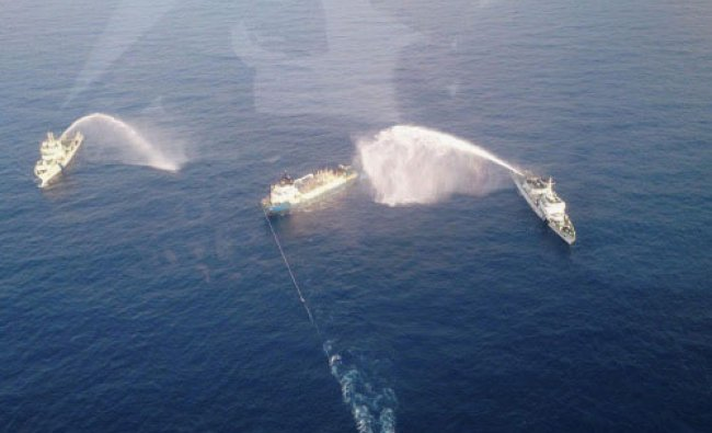The Coast Guard men dousing the fire that broke out at an ONGC supply vessel in Mumbai on ...