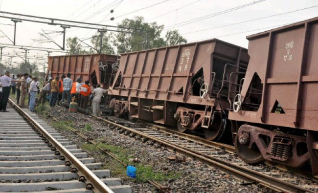 A goods train derails at Rampur railway station on Monday. PTI Photo
