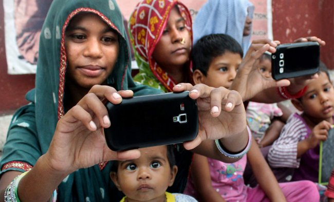 Women take selfies with their girl children as part of the \'Beti Bachao Beti Padhao\' campaign...