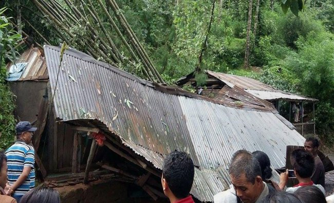 A house collapses at Mirik after landslides triggered heavy rains in Darjeeling...