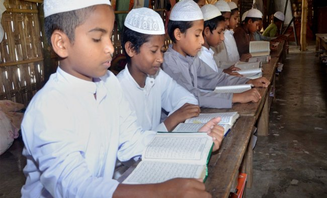 Children reading the Quran in the holy month of Ramadan in Agartala...