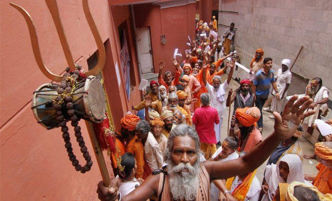 Sadhus stand in a queue to register themselves for the annual pilgrimage to the Amarnath cave...