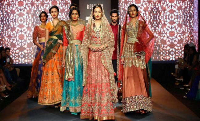 Models during the India Couture Week 2015 in New Delhi on Saturday...