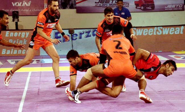 Players in action during a Pro Kabaddi League match between Daband Delhi (Red) and U Mumbai...