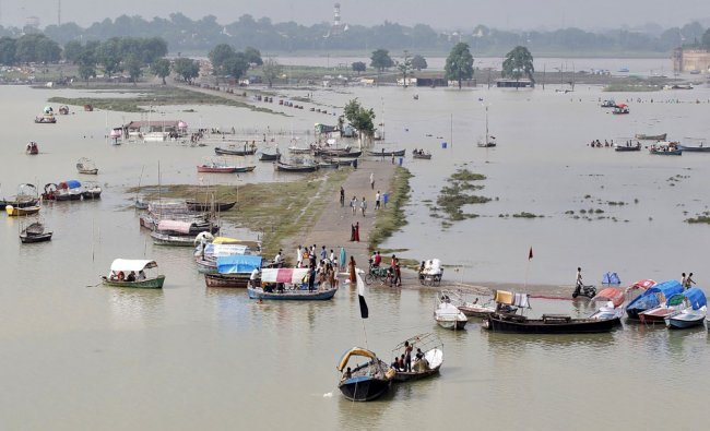 A view of a flooded road on the banks of river Ganga, pictured after heavy monsoon rains...