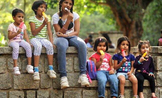 Kids testing ice cream cone on the occasion of \'Friendship day\'...