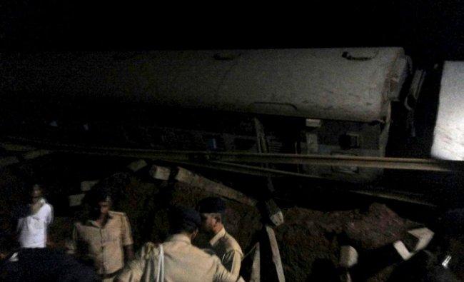 Police stand at the site of a train derailment near Harda, Madhya Pradesh...