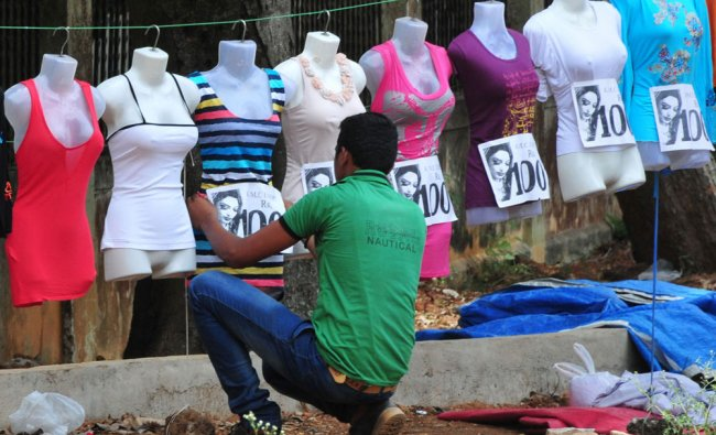A street wender prepares his dress materials for showing it to customers...
