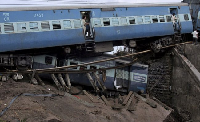 Damaged coaches of passenger trains are pictured after they derailed near Harda...