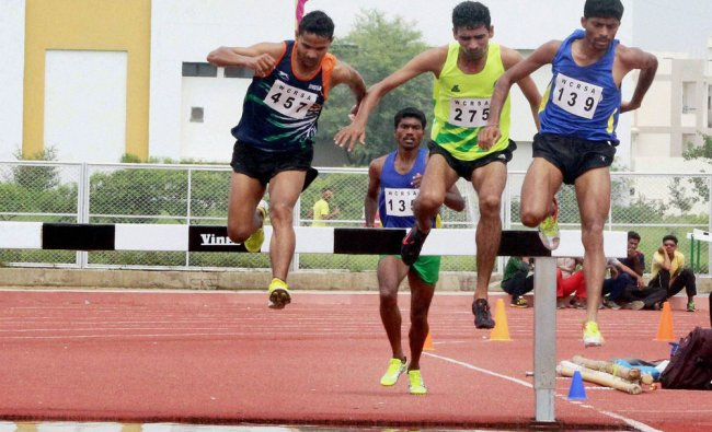 Sachin Patil (139) of Central Railway competes to win gold in 3000 mts steeple chase event during ..