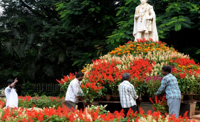 The colourfull floral arrangements made around Chamaraj Wadeyar\'s statue...