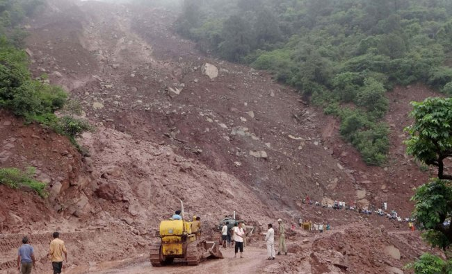 The slush and mud being cleared from the Jammu-Srinagar National Highway after landslides...
