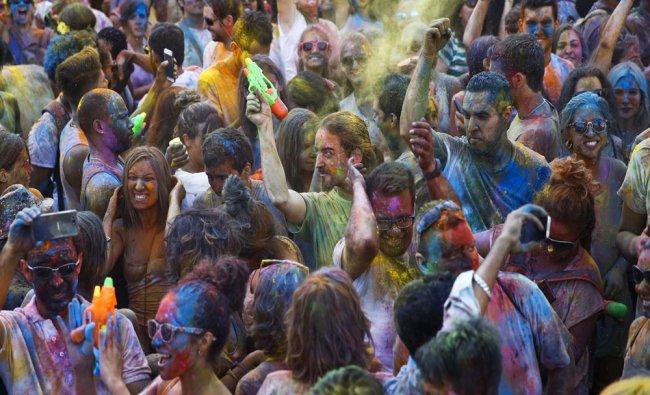 Revellers take part in the Monsoon Holi Madrid festival in Madrid, Spain...
