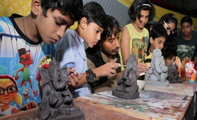 Children make eco-friendly Ganesha idols during a workshop in Thane on Sunday...