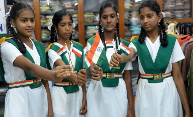 School students buying the National Flag for Independence day celebrations at Khadi Bhandar...