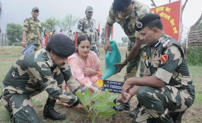 BSF officials planting saplings during a massive nationwide plantation...