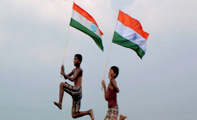 Village boys waving tricolour ahead of Independence day celebrations at Balurghat...