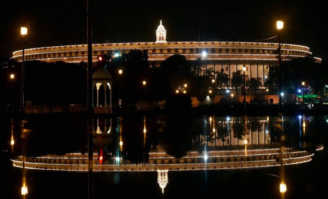 Parliament house illuminated in preparations for Independence day celebrationsin New Delhi...
