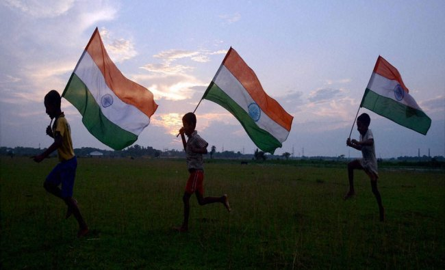 Boys run with Tricolours ahead of Independence day celebrations...