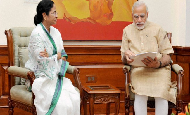 Modi with Mamata Banerjee in a meeting in New Delhi...